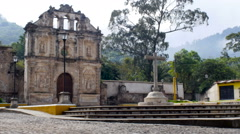 A wide shot of an old church and empty plaza in Antigua, Guatemala in the day Stock Footage