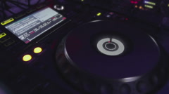 DJ's modern mixing console with channel inputs playing music, turning around Stock Footage