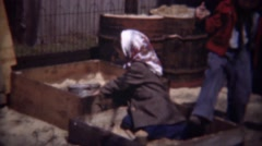 1948: Poor immigrant girl kids playing in industrial sandbox. Stock Footage