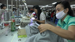 Garment factory producing clothing for Western brands in Vietnam Stock Footage