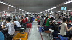 Walking through a busy garment manufacturing factory in Vietnam, Southeast Asia Stock Footage