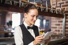 Barmaid taking orders on notepad Stock Photos