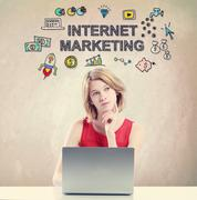 Internet Marketing concept with woman working on laptop Stock Photos