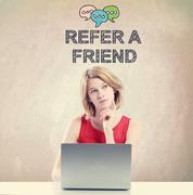 Refer A Friend concept with woman working on a laptop - stock photo