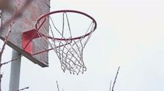 Old basketball hoop on the street with a grid Stock Footage
