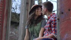 Adventurous Couple Explore City Together, They Sit In An Abandoned Building - stock footage