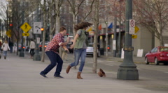 Woman's Hat Flies Off Her Head, Her Boyfriend Picks It Up, They Laugh Stock Footage