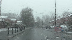 Driving in sleet or wet snow in town Stock Footage