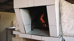 Pizzeria oven with fire burning Stock Footage