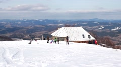 Time Lapse of Kids Building a Snowman in the Winter Mountains Stock Footage
