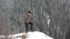Man in outerwear standing in snow Stock Footage