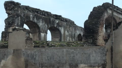 Wide pan up of old arches of a ruined church in Antigua, Guatemala Stock Footage