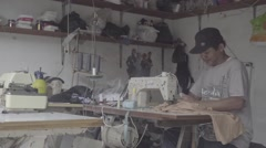 Indonesian man using sewing machine in a workshop, editorial, ungraded, slog2 Stock Footage