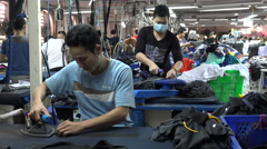 Busy production line, ironing clothing in a garment factory in Vietnam, Asia Stock Footage