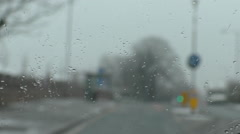 Driving in sleet, focus on windshield Stock Footage