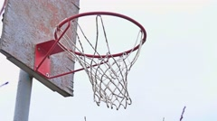 Action shot of basketball going through basketball hoop and net Stock Footage
