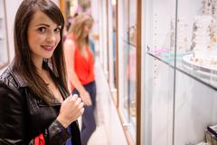 Portrait of beautiful woman in a jeweler shop Stock Photos