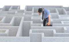 Depressed businessman standing in the middle of a maze. 3d illustration. Stock Illustration