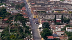 Pan up establishing shot of the ancient city streets of a Central American City Stock Footage