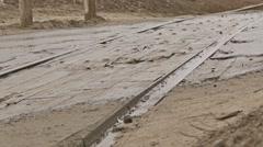 Bad asphalt road cars drive on dirt pits autumn rain Stock Footage