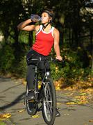 Cyclist drinking water - stock photo