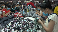 Crowded factory floor, female employees at work, clothing manufacturing Vietnam Stock Footage