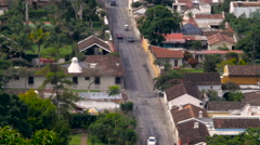 Establishing shot of traffic driving on cobble stone streets in Latin America Stock Footage