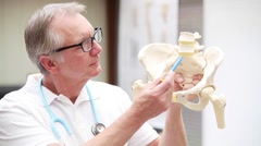 Mature medicine demonstrating lumbal spine with disci Stock Footage