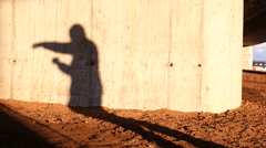 Shadow of the boxer man boxing on the wall, runner training in the morning Stock Footage