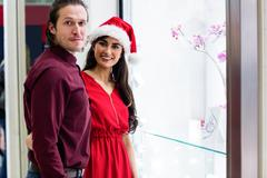 Portrait of couple in Christmas attire Stock Photos