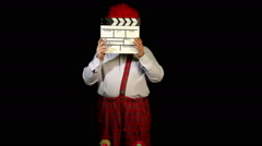 Clown with a movie clapperboard Stock Footage