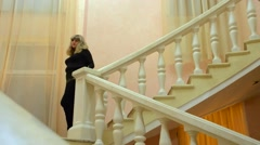 A Woman Walks Down the Stairs Stock Footage