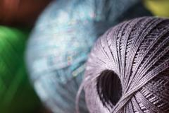 Stock Photo of Hank yarn lit by the sun close up