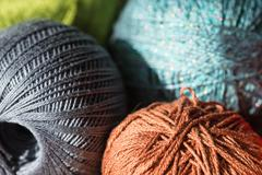 Skeins of yarn of different colors close up - stock photo