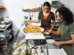 Preparing food in delicatessen kitchen Stock Photos