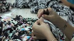 Closeup hands, scissors, cutting, sheets, textile, garment factory Vietnam Stock Footage