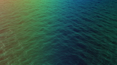 Stock Video Footage of top view of multicolored water waves on sunset