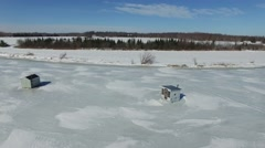 4k aerial ice fishing huts at two rivers point Stock Footage