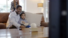 4K Happy mixed ethnicity family relaxing at home & watching TV - stock footage