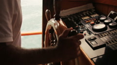 Captain keeps the wheel of his yacht close up Stock Footage