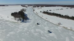 4k aerial ice fishing huts circling high above view - stock footage