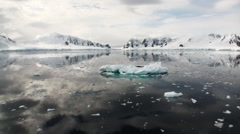 Reflection of Antarctica Mountain in water surface Stock Footage