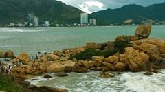 Tourists Climb on the Hon Chong Rocks in Nha Trang. Video UltraHD Stock Footage
