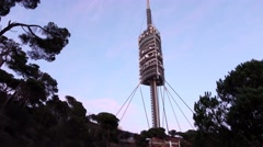 Torre de Collserola, telecommunication tower at Tibidabo hill, tilt shot in dusk Stock Footage