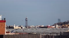 Torre Jaume I aerial lift steel tower far away, telephoto view over rooftops Stock Footage