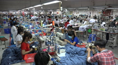 Busy factory floor, garment manufacturing company, labor force in Vietnam, Asia - stock footage