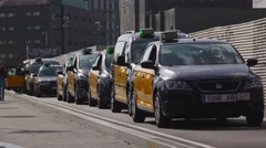 Barcelona taxi car stand still in line, waiting in queue. Telephoto lens shot Stock Footage