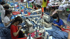 Garment factory, third world, developing country, employment, Vietnam, Asia - stock footage