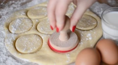 Woman Stamping Rolled out Dough Stock Footage
