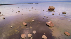 Clear water on the rocky shore in Altja Stock Footage